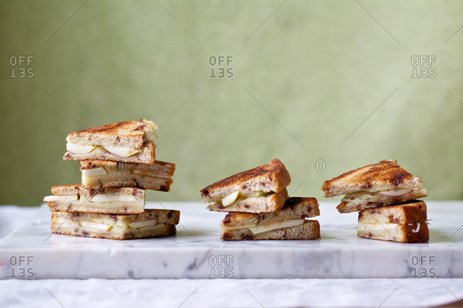 Stacked grilled cheese sandwiches with apple