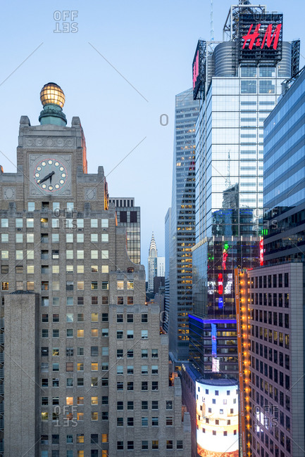 April 12, 2015: Corporate office buildings and historic clock tower in Manhattan