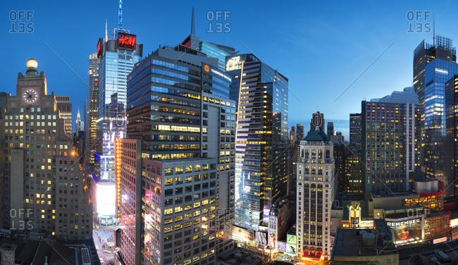 April 12, 2015: Corporate skyscrapers illuminated at night in Manhattan