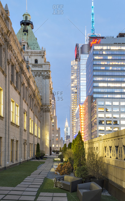 April 13, 2015: Modern corporate building beside a traditional gothic style structure