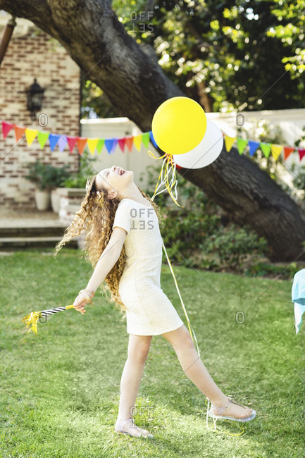 A laughing girl at a birthday party