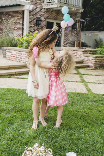 Girls hug outside at a birthday party
