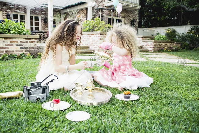 A tea party with cupcakes, cameras, and girls