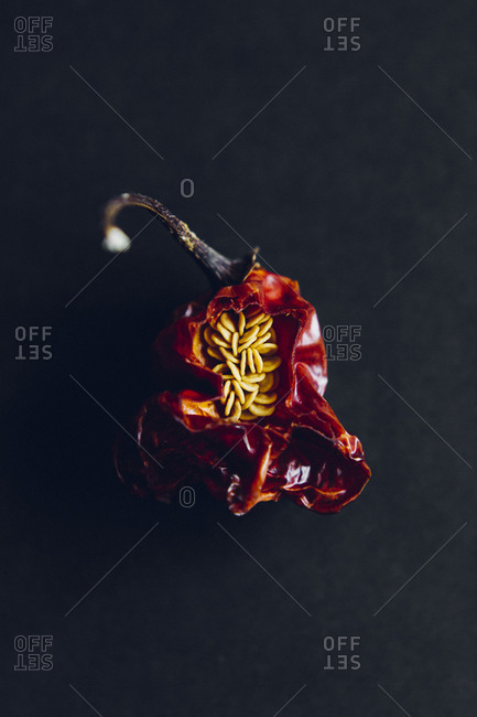 Dried red chili pepper on a black background