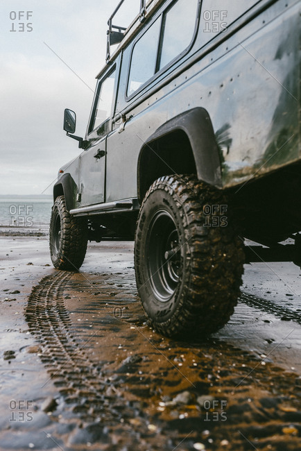 Sport utility vehicle parked on a beach