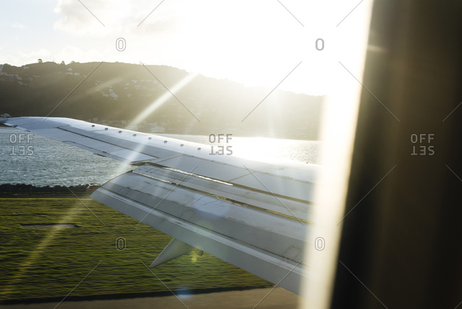 Airplane wing and flaps seen from a passenger window