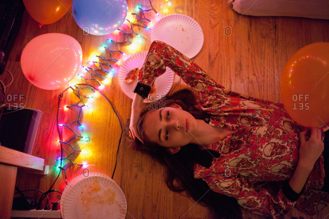 Young women and string lights at a party