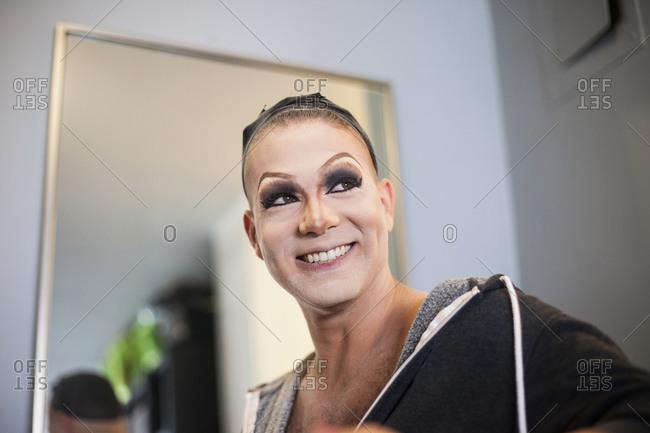 Young man wearing drag makeup
