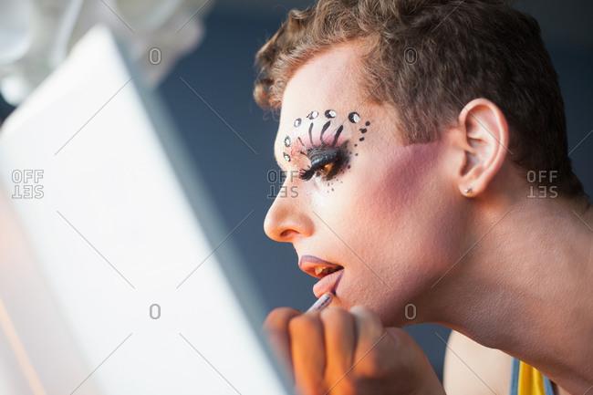 Man applying drag queen makeup