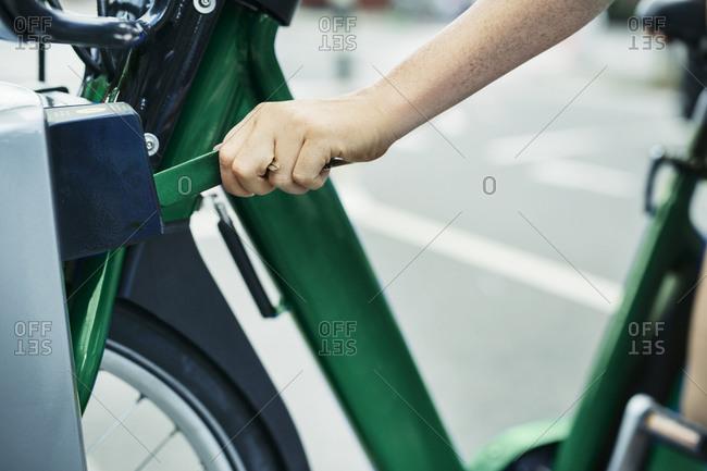 Woman getting a bike from bike share