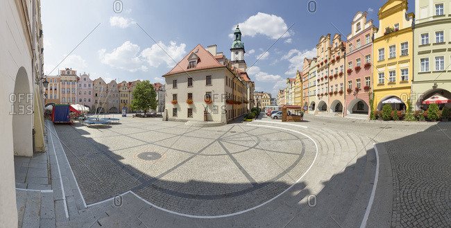 Town Hall surrounded by baroque tenement houses with arcades