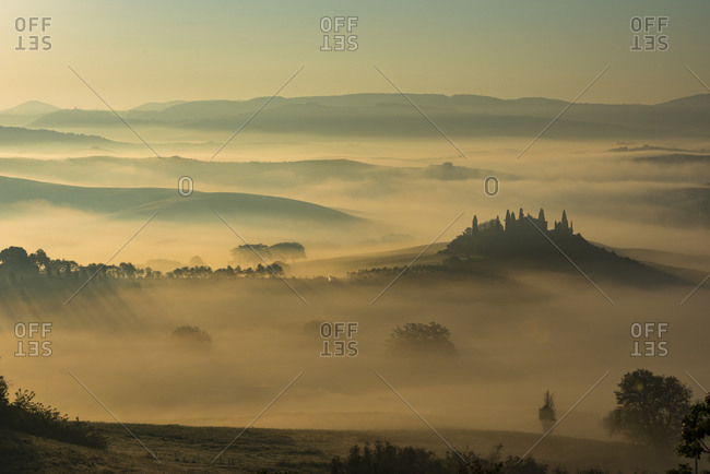 View of Val d'Orcia in the morning in the fog