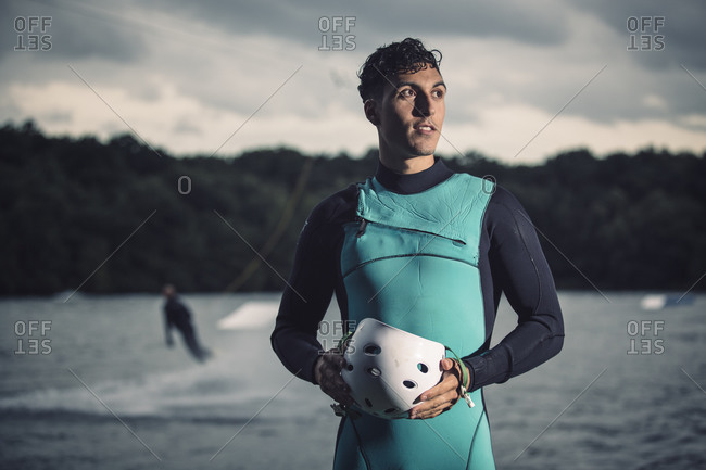 Portrait of young wakeboarder with safety helmet