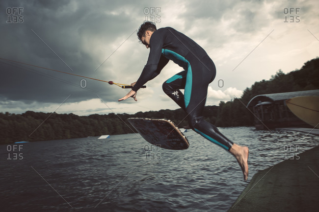 Young wakeboarder jumping in the air