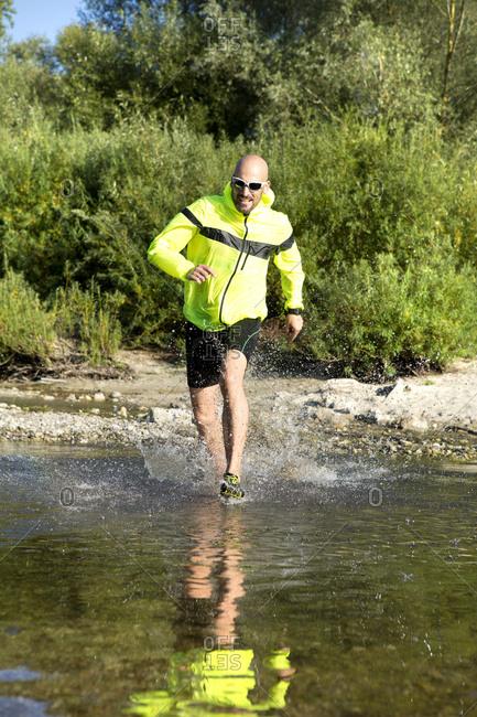 Man in sports wear sprinting in water