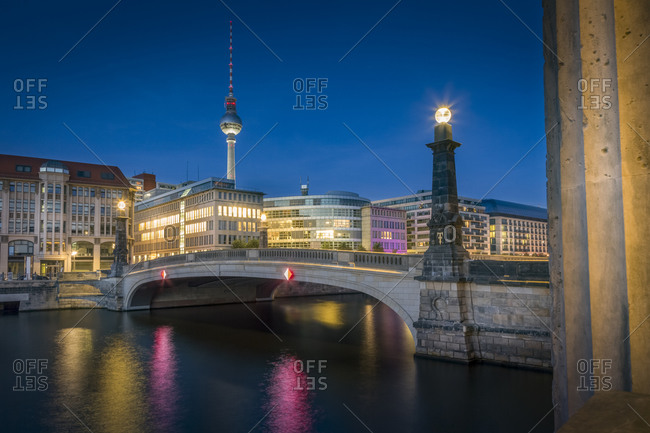 Bridge over the Spree river with TV-Tower and historic arcade