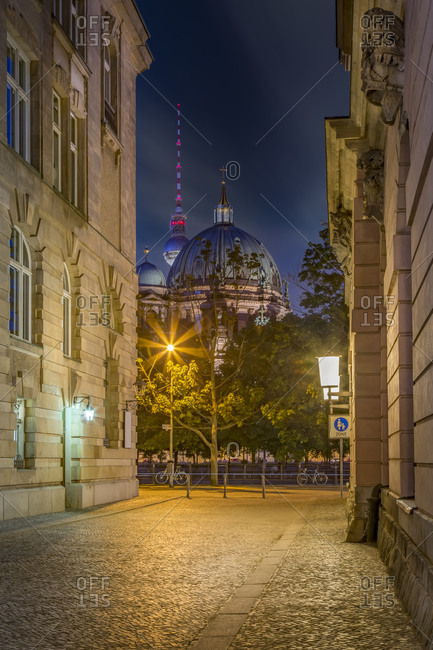 Berliner Dom and TV-Tower seen through a narrow street at night