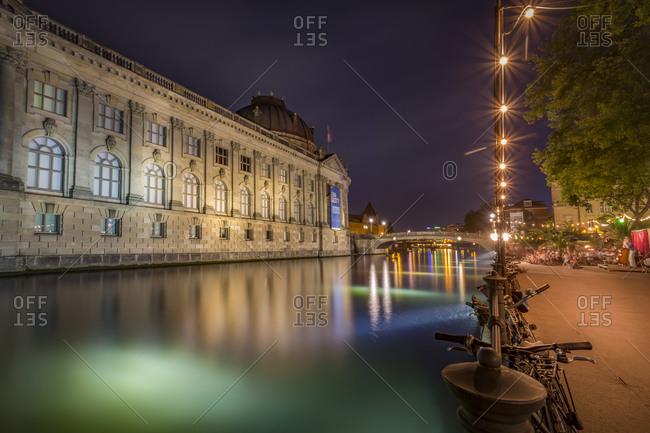 Bode Museum Spree river and illuminated promenade at night