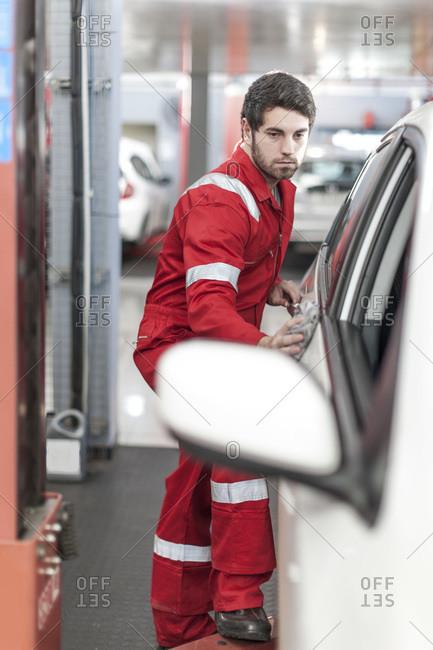 Man finishing waxing a car