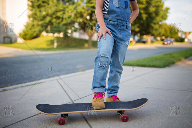 Girl with foot on skateboard