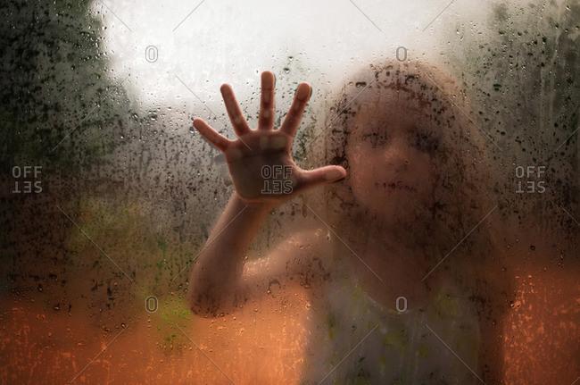 Hand on door in the rain
