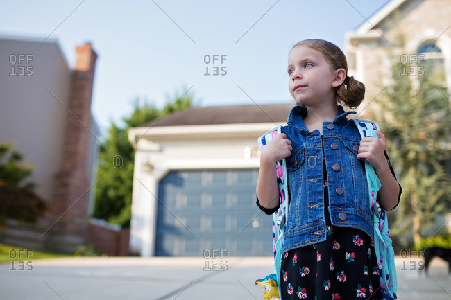 Girl with backpack on looking to the right