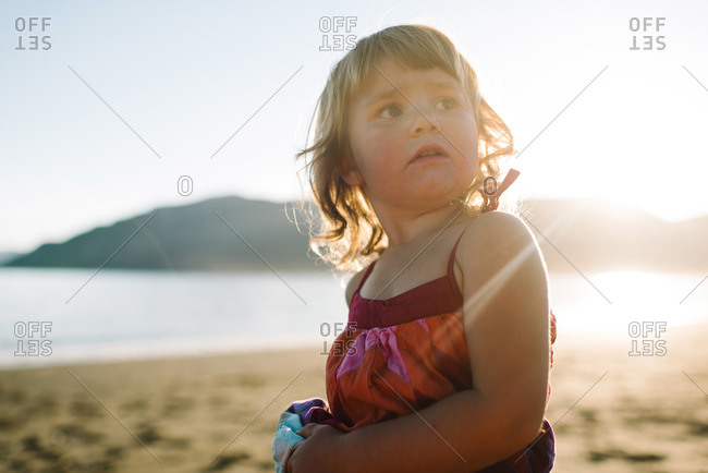 Young girl staring off on a beach