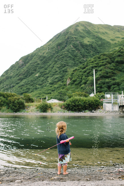 Small girl casting her fishing pole