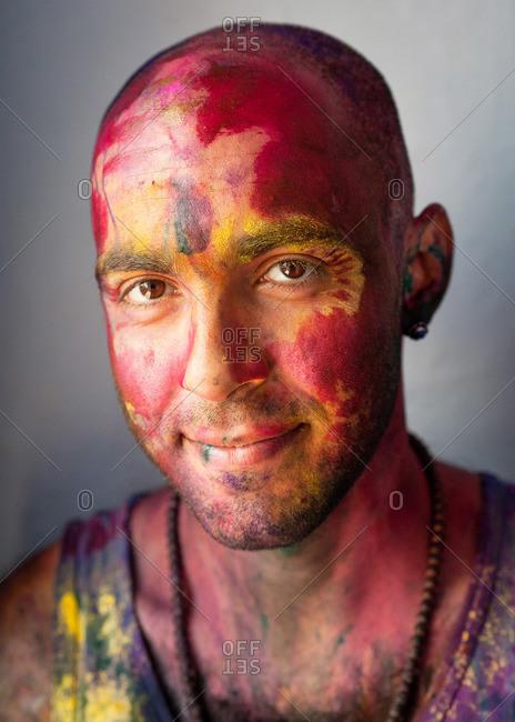 Varanasi, UttarPradesh, India - September 15, 2014: Man covered in colored powder from a Holi festival