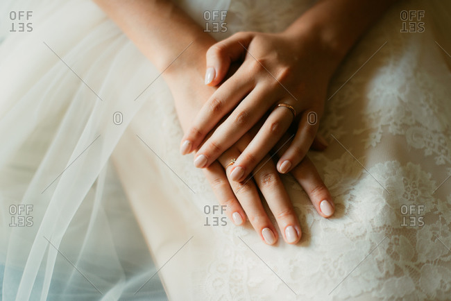 Bride's hands crossed on lap