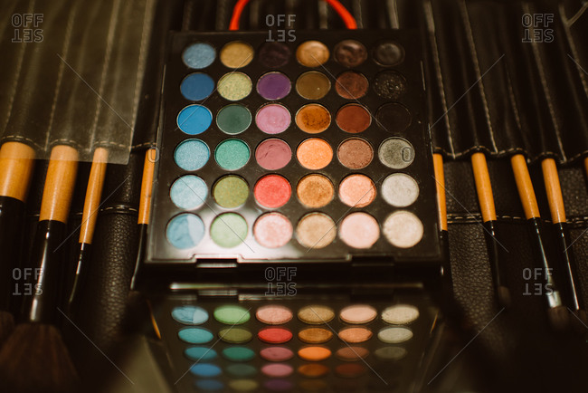 Various shades of eye shadow and brushes