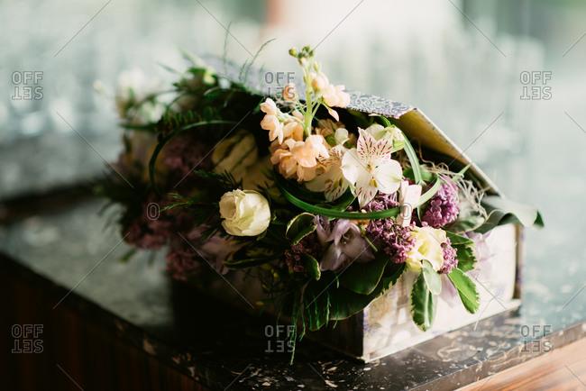 Box of floral arrangements for wedding