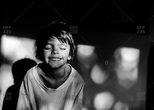 Little boy in an oversized t-shirt smiling