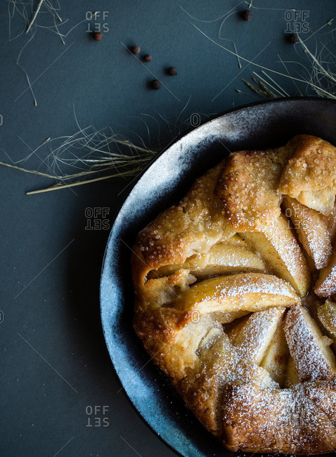 Close-up of fresh apple galette dusted with confectioners sugar