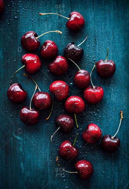 Fresh red cherries on dark background