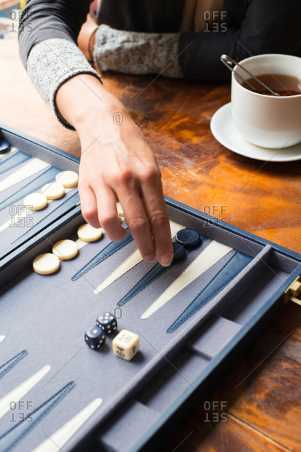 Woman playing backgammon in a coffee shop