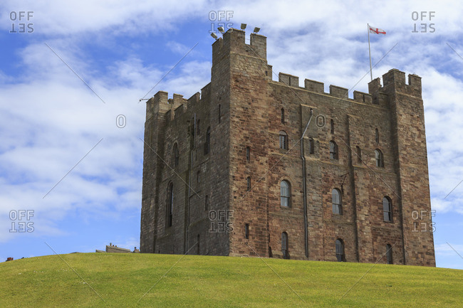 Bamburgh Castle, The Keep, with English flag of St George, Bamburgh, Northumberland, England, United Kingdom