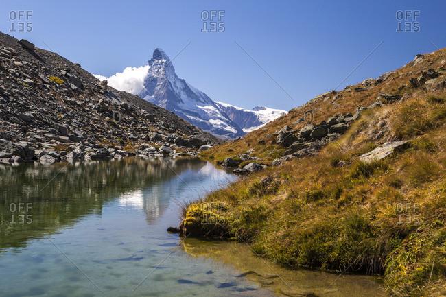 The Matterhorn at dawn seen from Stellisee, Zermatt, Switzerland