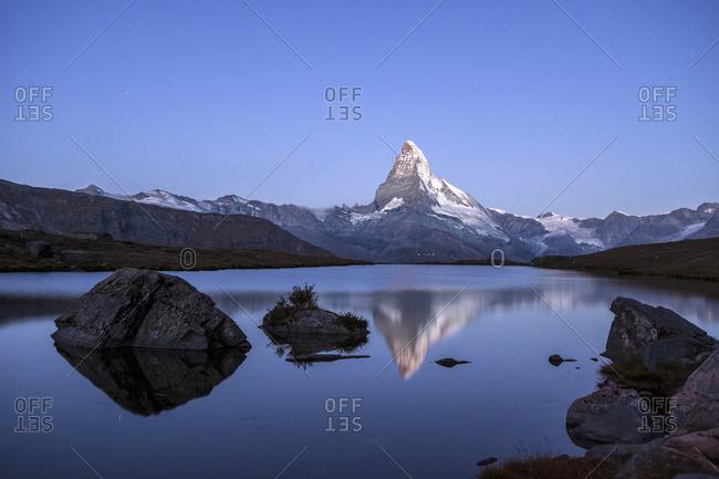 The Matterhorn reflected in Stellisee at sunrise, Zermatt, Switzerland
