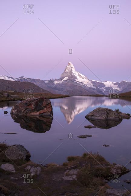 The Matterhorn reflected in Stellisee at dusk, Zermatt, Switzerland
