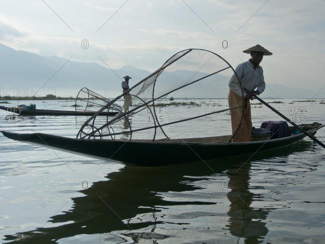Shan state, Myanmar - December 17, 2014: Fishermen cast their nets in Inle lake, Shan state, Myanmar
