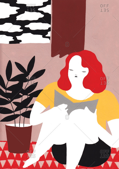 Red haired woman reading a book while seated on floor next to potted plant