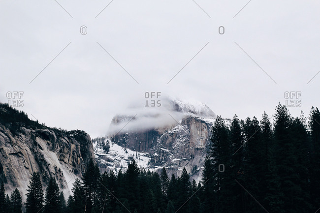 Snowy mountain peak in the mist