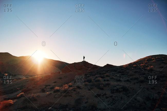 Man standing on a desert mountaintop