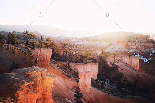 Woman standing on a desert mountain cliff