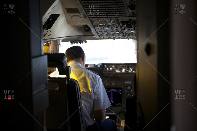 An airplane pilot in the cockpit