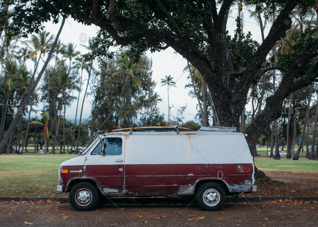 Honolulu, Hawaii - March 24, 2015: A beat-up van parked on the side of a road