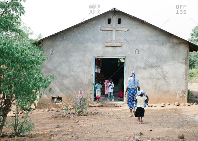 Tanzania - circa June 2012: Women and children enter a church