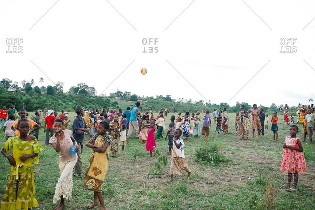 Tanzania - circa June 2012: Children plan in a field