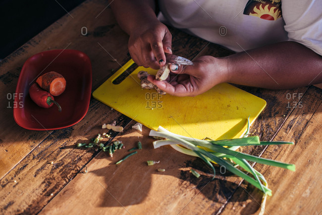 A woman prepares fresh ingredients on a table in the Philippines